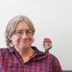 Professor Randall with a Harry Potter toy on his shoulder