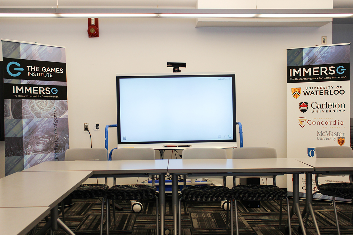 Large TV screen setup in office space.