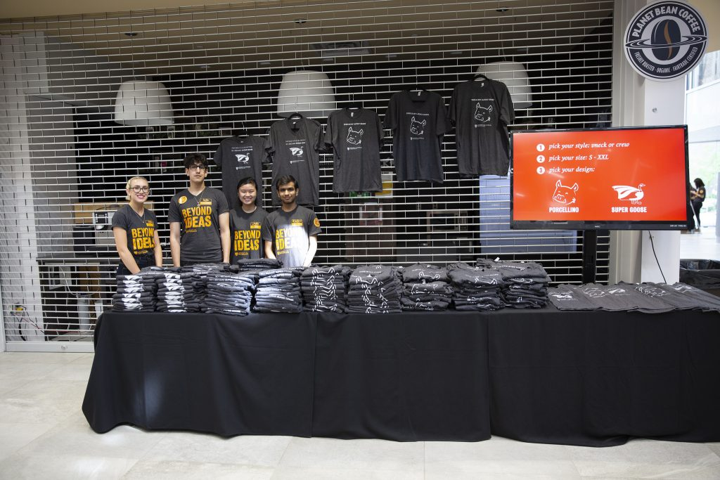 Akshar and three other volunteers pose with limited edition t-shirts at You @ Waterloo Day